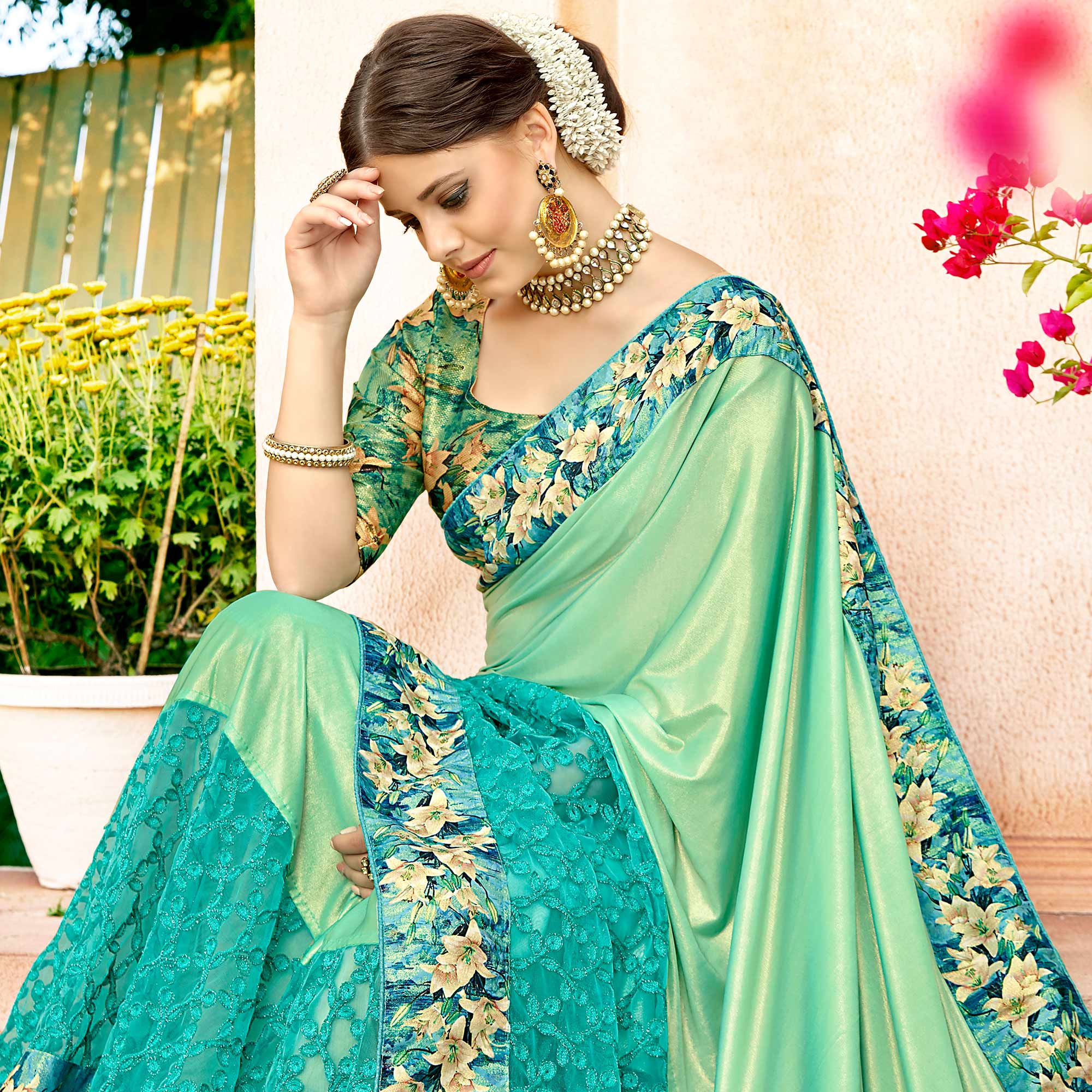 Gorgeous Turquoise Green  Colored Partywear Printed Lycra & Net Saree