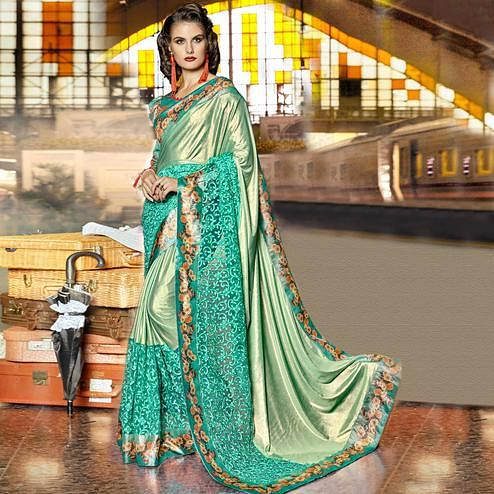 Mesmerising Pastel Green Colored Party Wear Printed Lycra & Net Saree