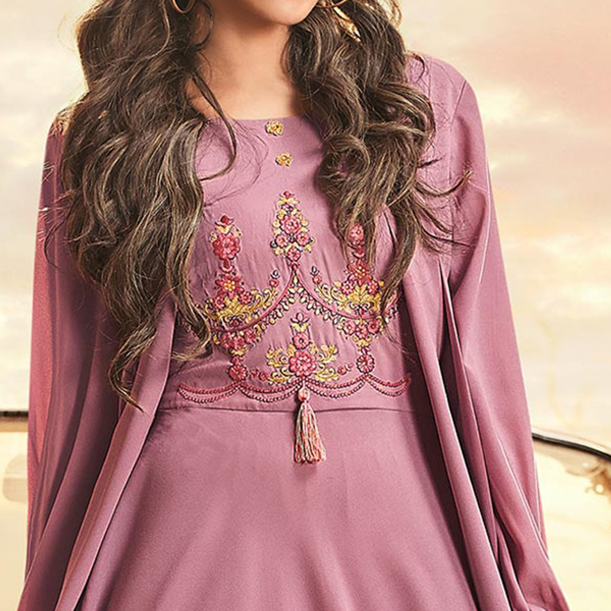 Imposing Light Mauve Colored Partywear Embroidered Georgette Gown