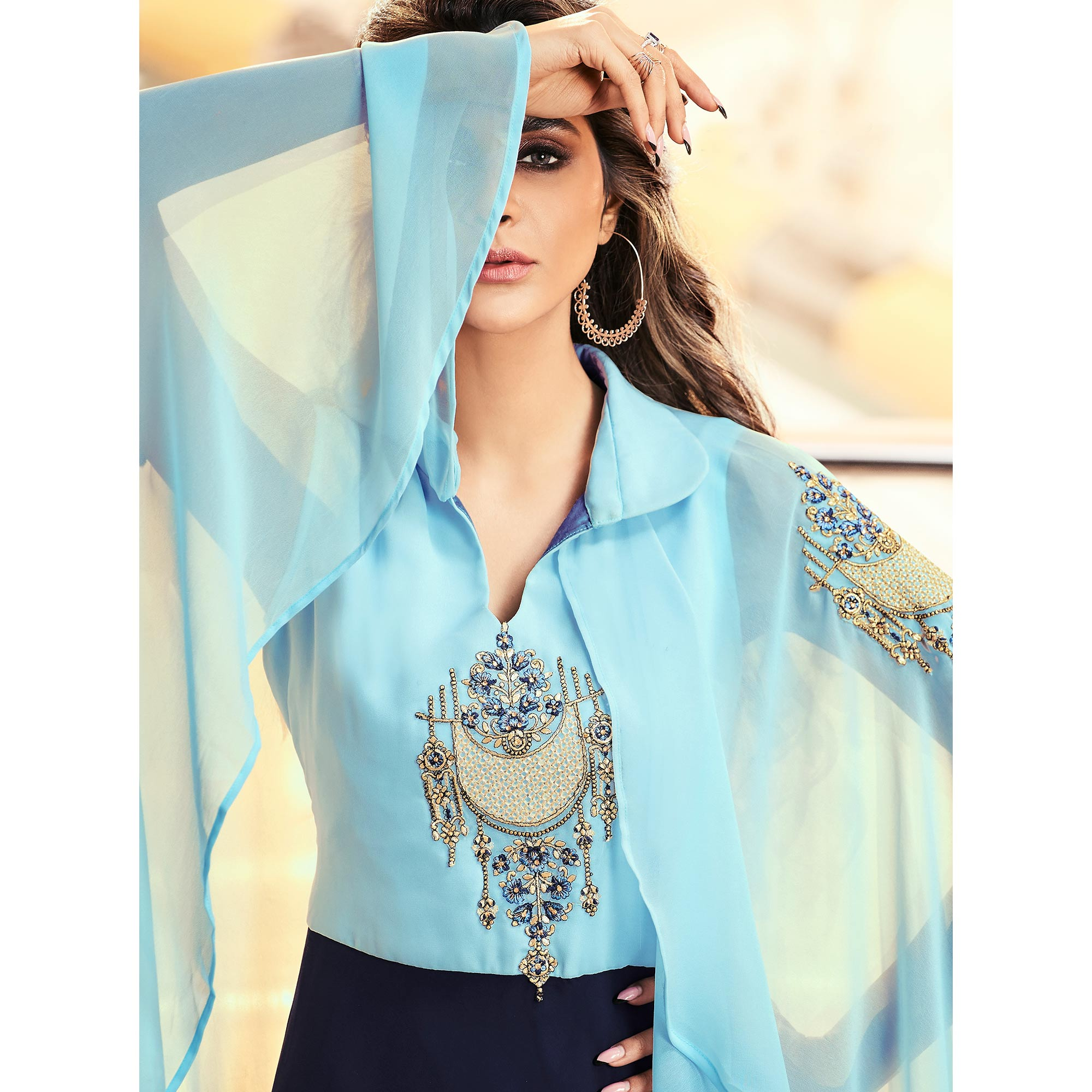 Impressive Blue Colored Partywear Embroidered Georgette Gown