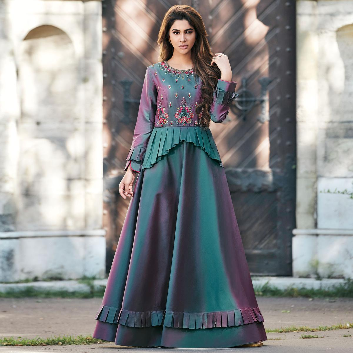 Mesmeric Teal Green Colored Partywear Embroidered Tapeta Silk Gown