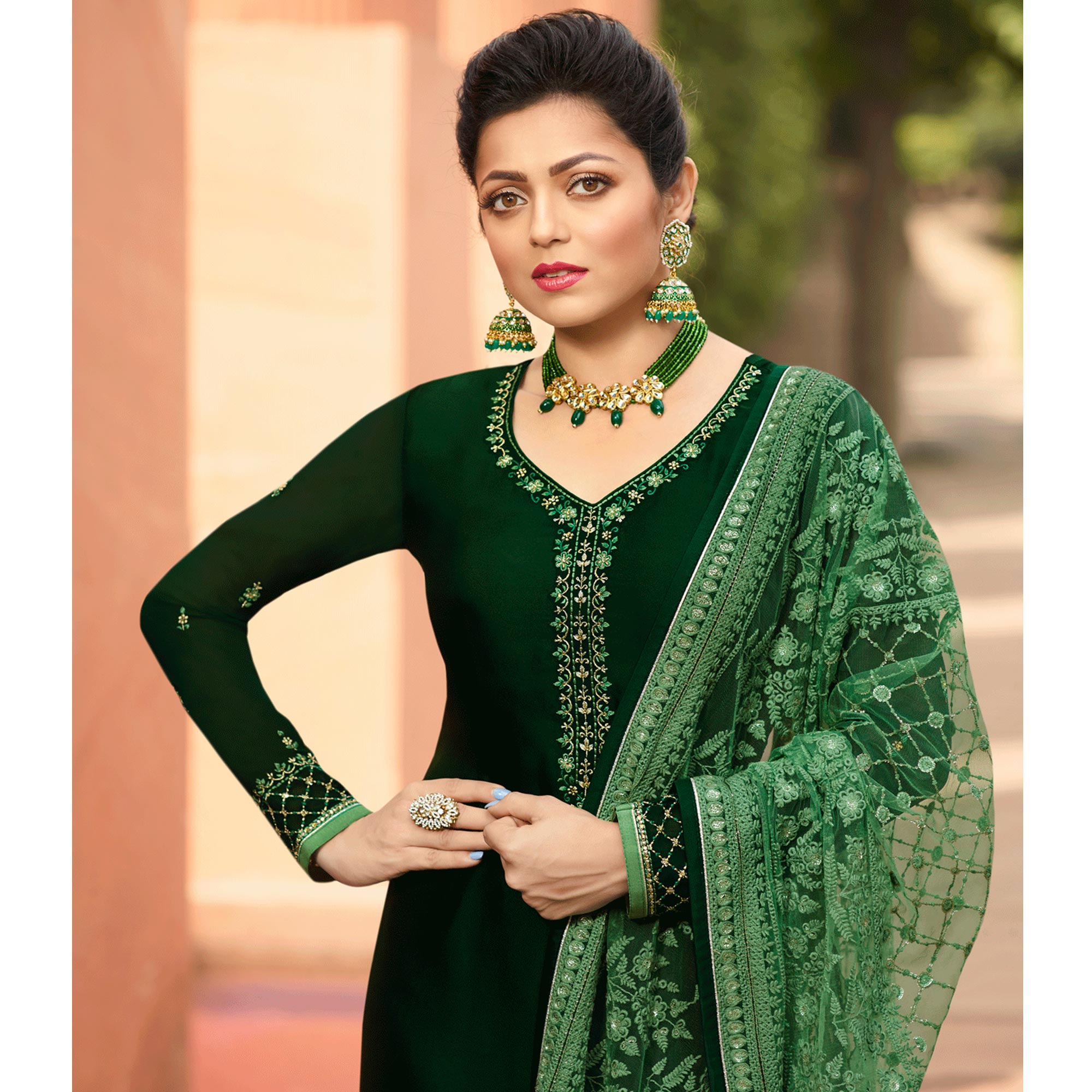 Attractive Dark Green Colored Partywear Embroidered Satin Georgette Suit