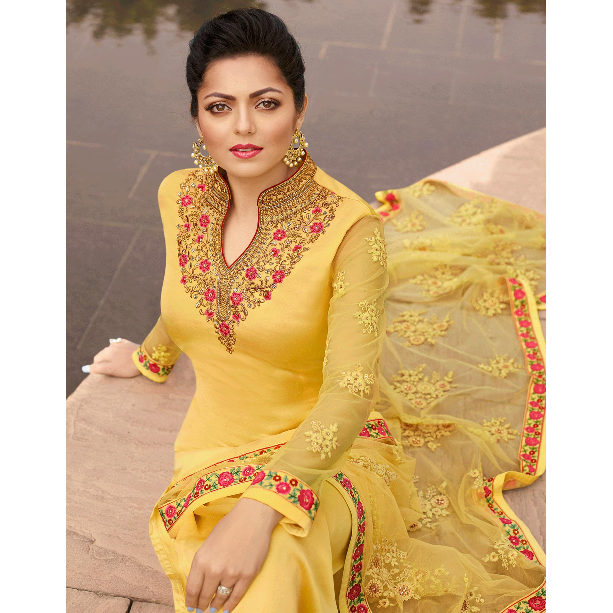Beautiful Yellow Colored Partywear Embroidered Satin Georgette Suit