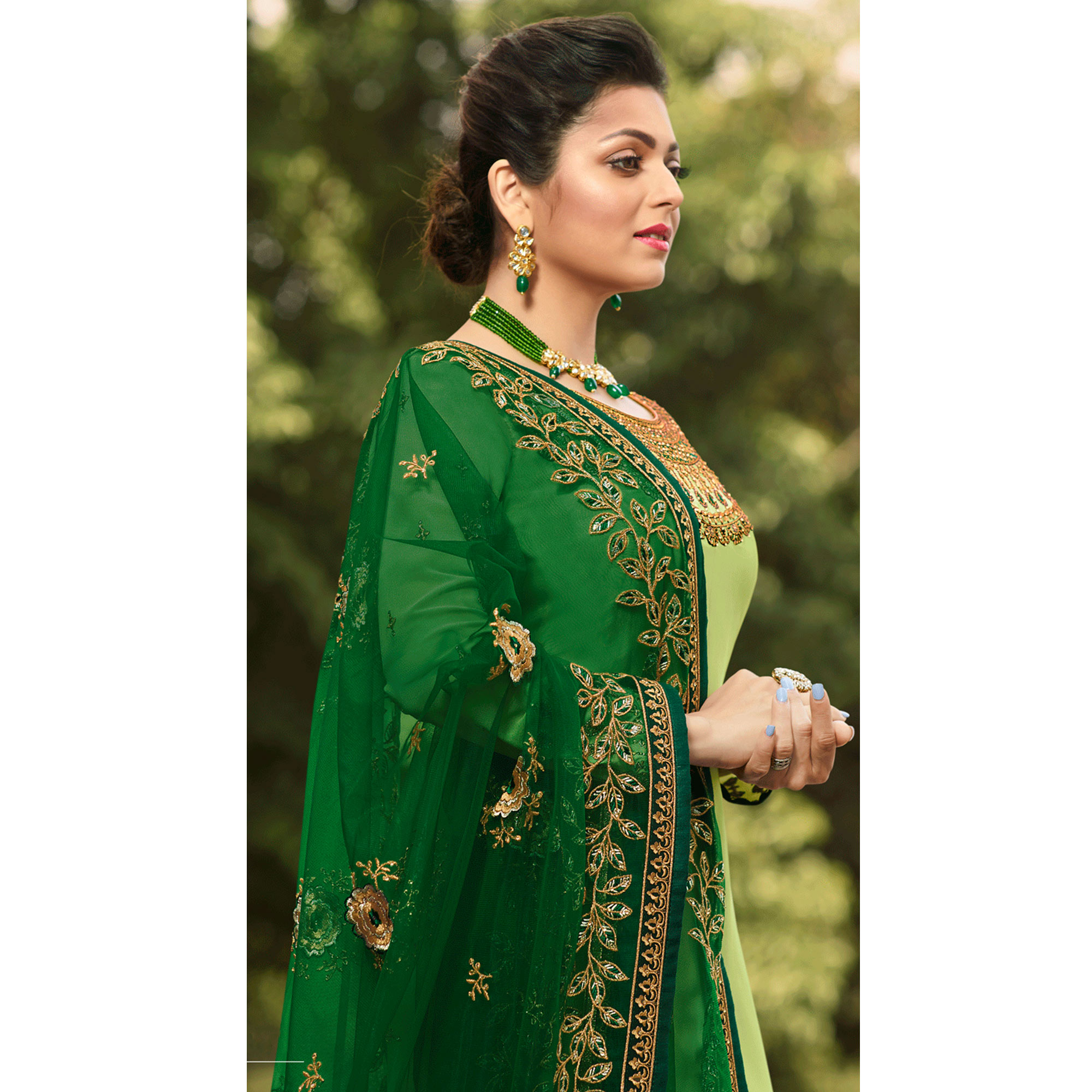 Delightful Mint Green Colored Partywear Embroidered Satin Georgette Suit