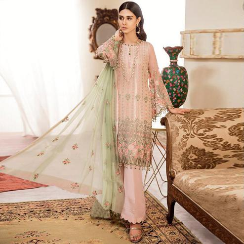 Gleaming Peach Colored Partywear Embroidered Georgette-Net Palazzo Suit