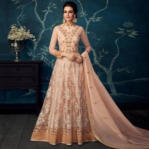 Adorning Pastel Peach Colored Partywear Embroidered Georgette Anarkali Suit