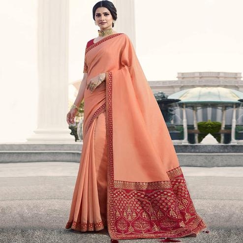 Delightful Peach Colored Partywear Embroidered Silk Saree