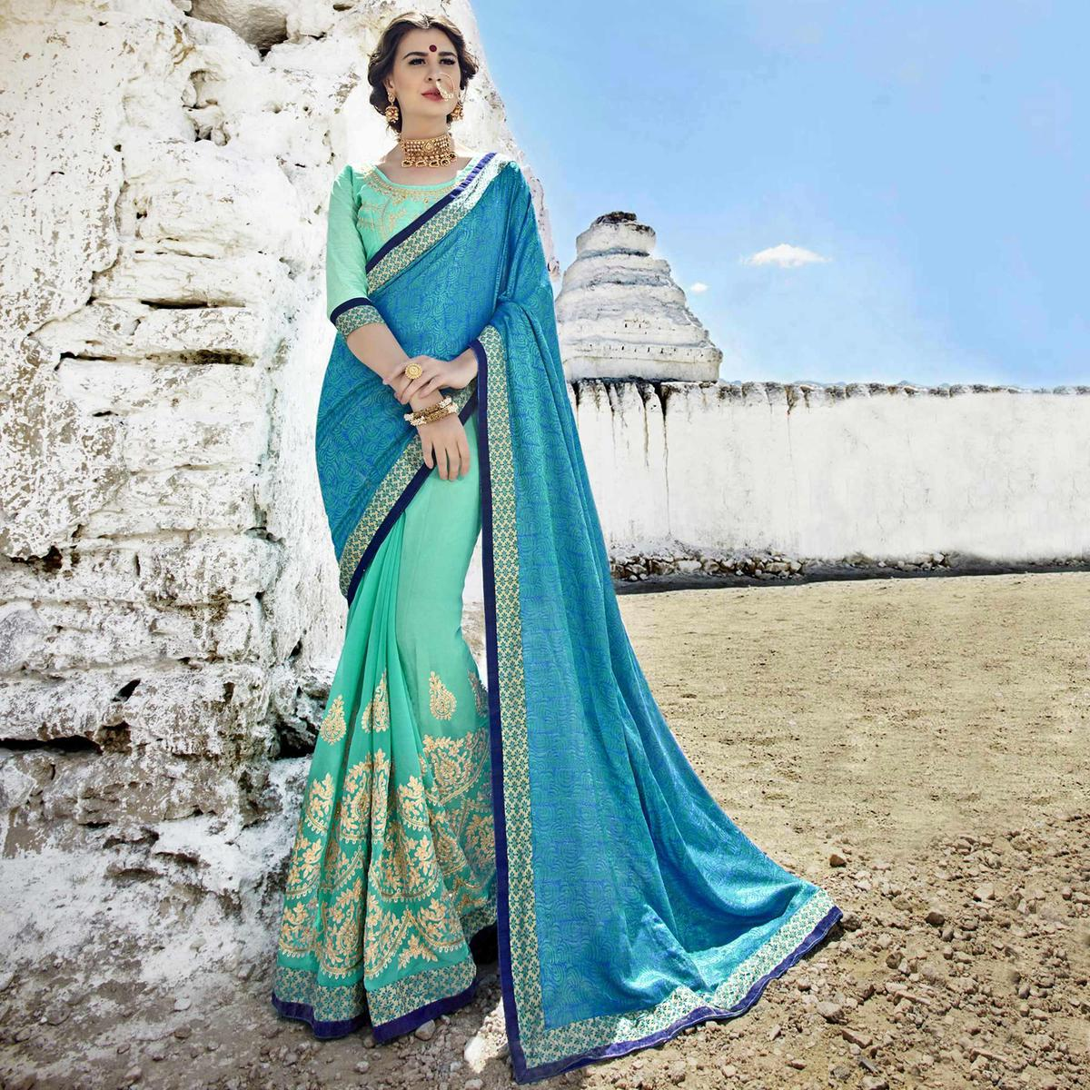 Prominent Turquoise-Blue Colored Party Wear Embroidered Georgette Saree