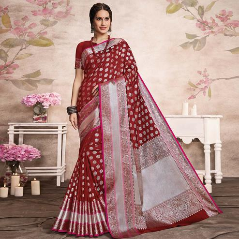 Hypnotic Maroon Colored Festive Wear Woven Silk Saree