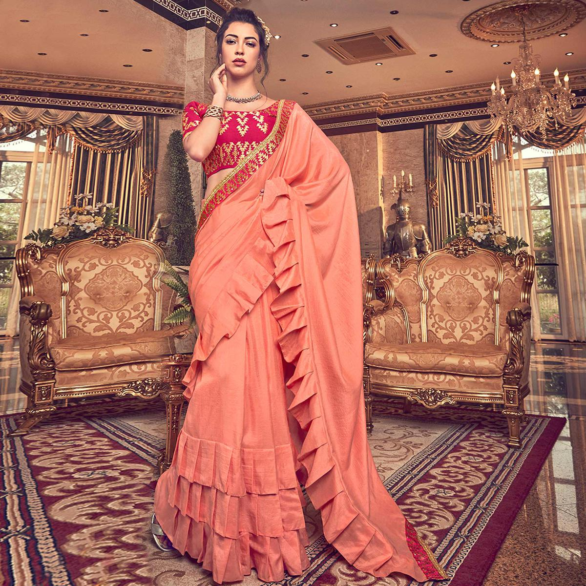 Classy Peach Colored Partywear Embroidered Georgette Saree
