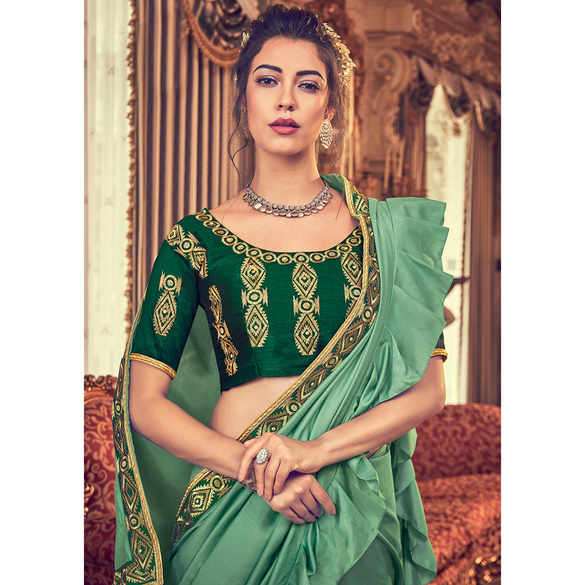 Capricious Mint Green Colored Partywear Embroidered Georgette Saree