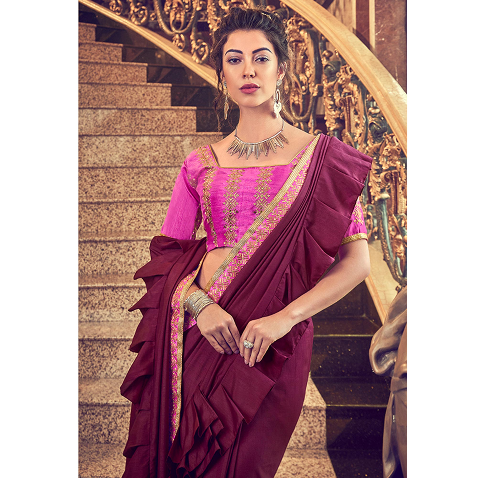 Groovy Wine Colored Partywear Embroidered Georgette Saree