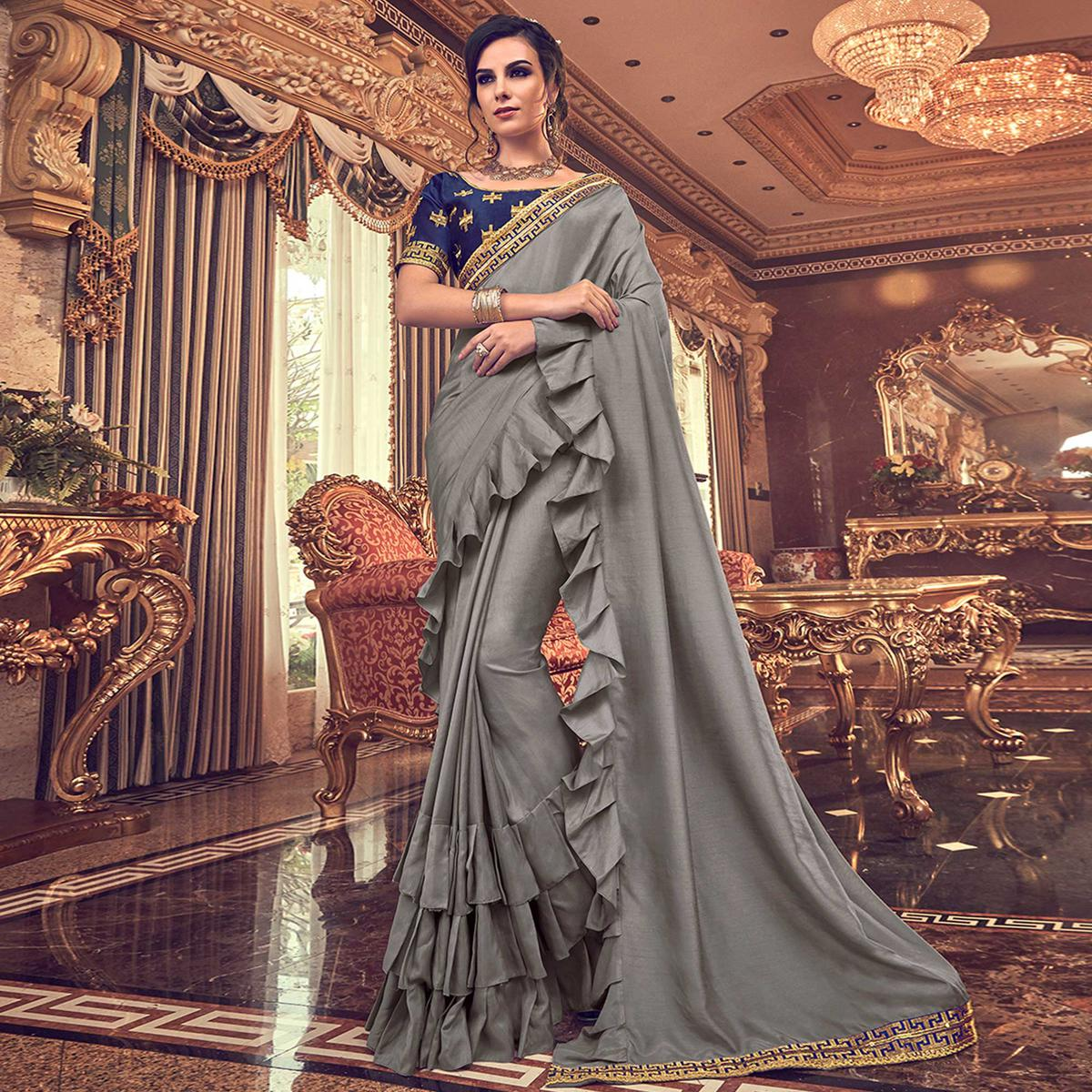 Arresting Gray Colored Partywear Embroidered Georgette Saree