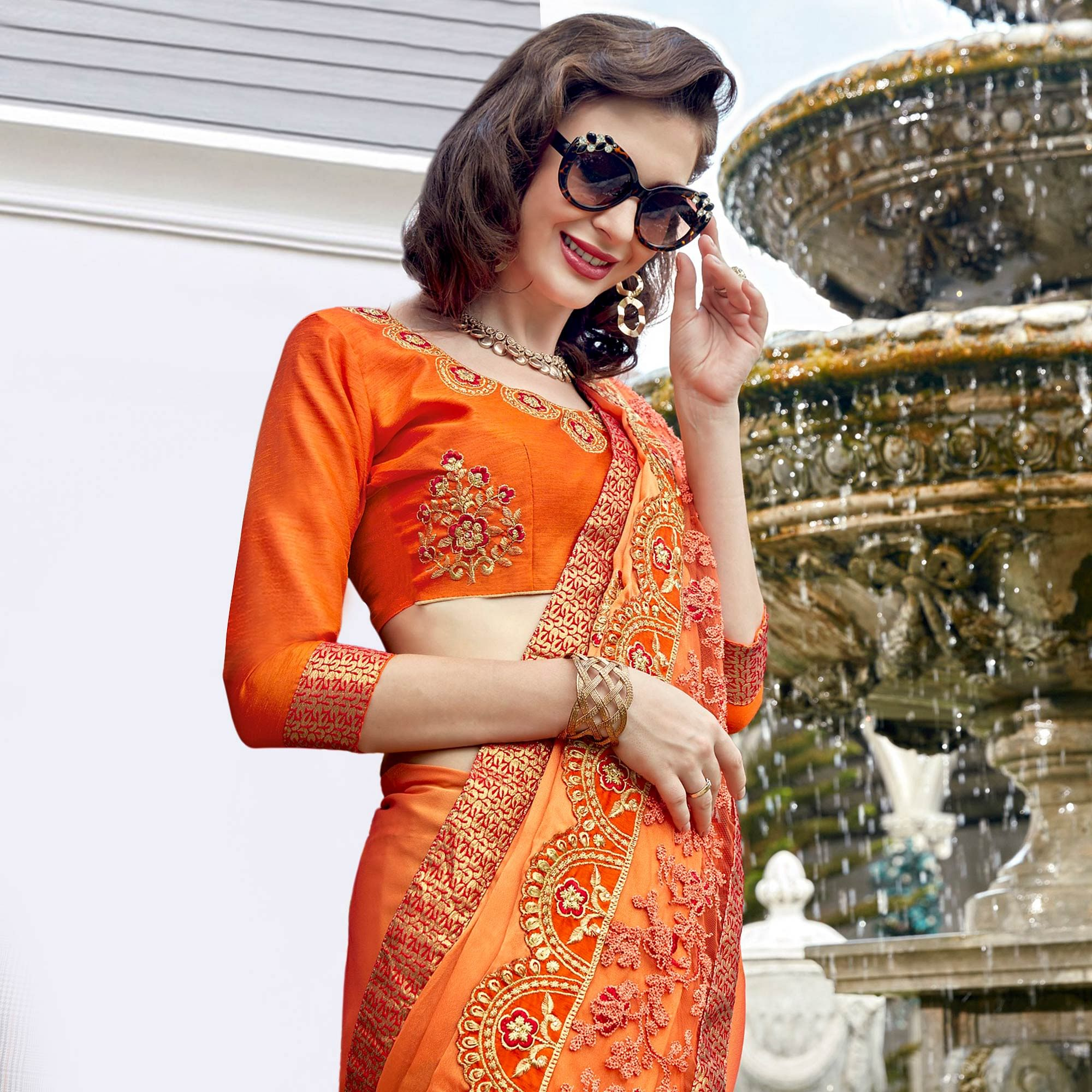 Gorgeous Orange Colored Partywear Embroidered Georgette Saree