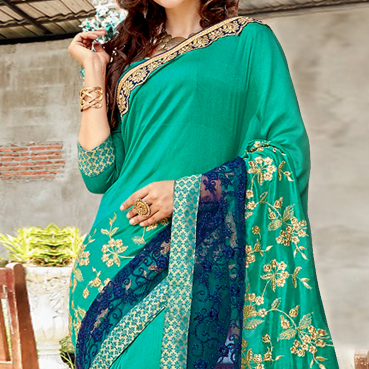 Ideal Turquoise Green Colored Partywear Embroidered Georgette Saree