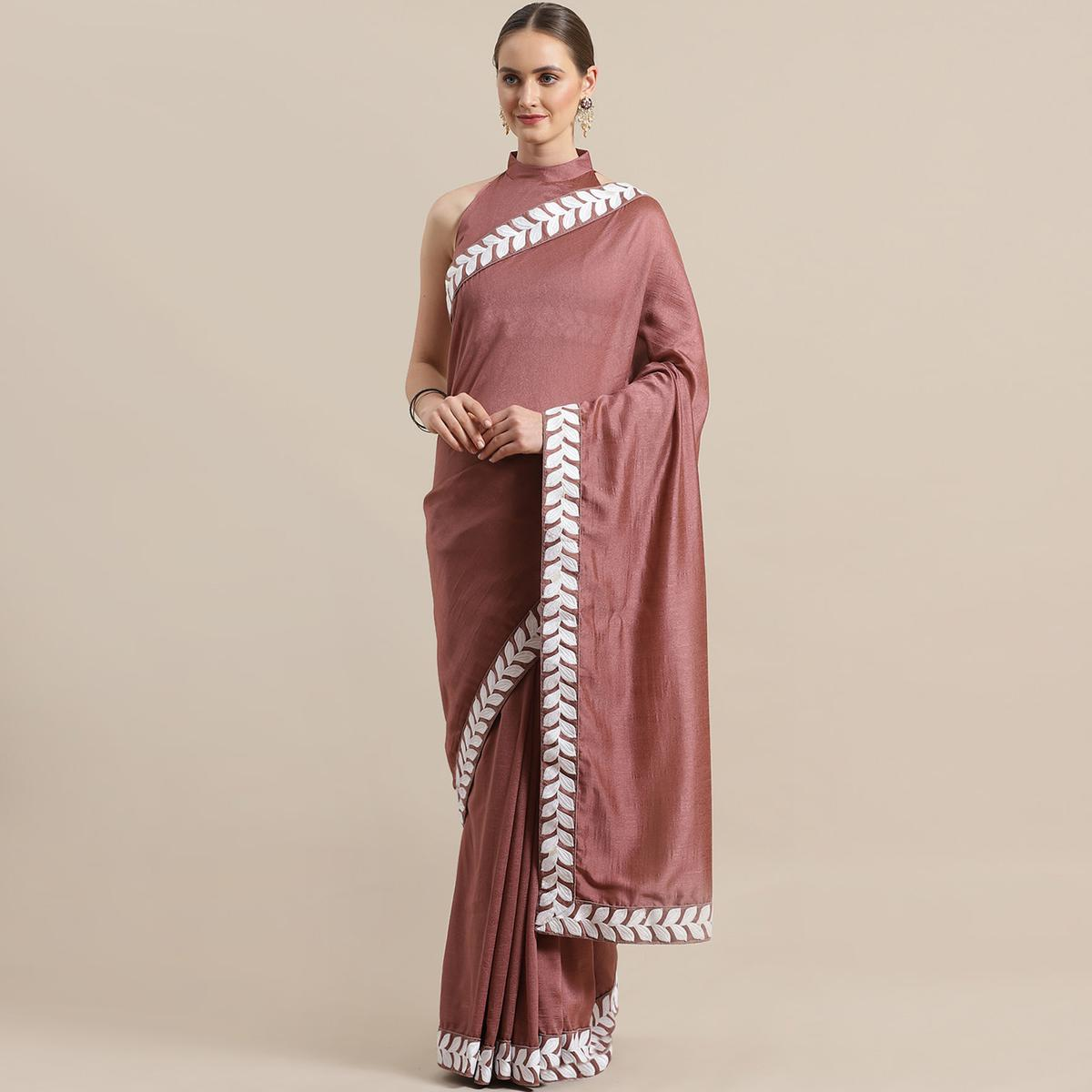 Preferable Light Mauve Colored Partywear Embroidered Georgette Saree