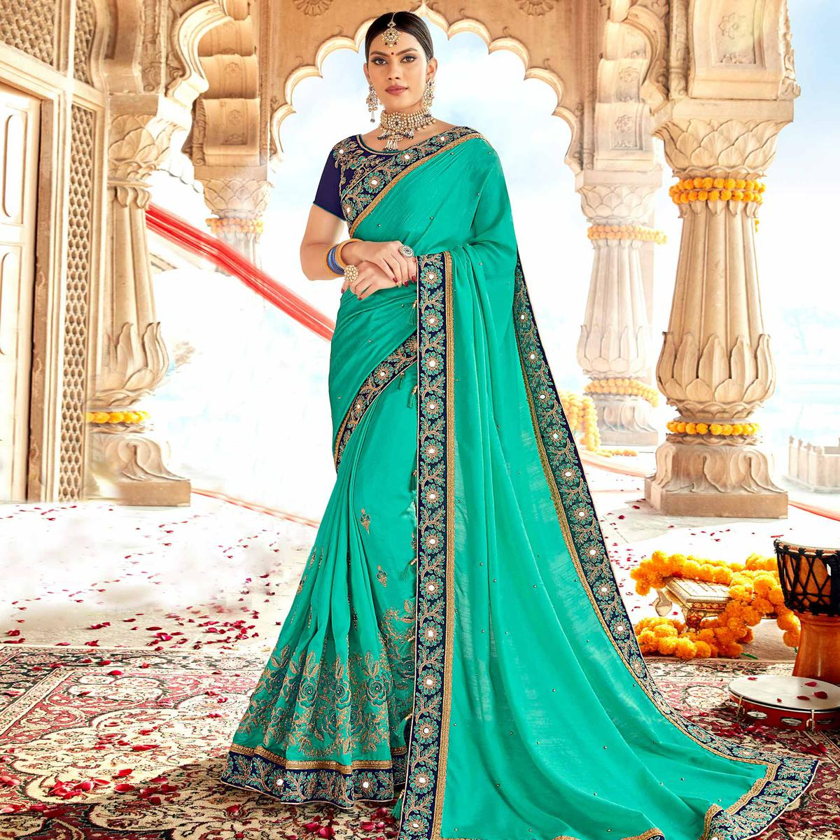 Flamboyant Turquoise Green Colored Partywear Embroidered Georgette-Silk Saree