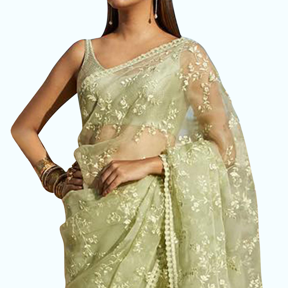 Amazing Mint Green Colored Partywear Embroidered Nylon Net Saree