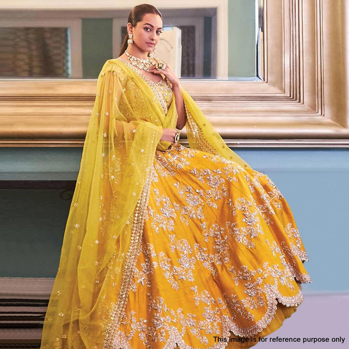 Energetic Yellow Colored Partywear Embroidered Tapeta Silk Lehenga Choli