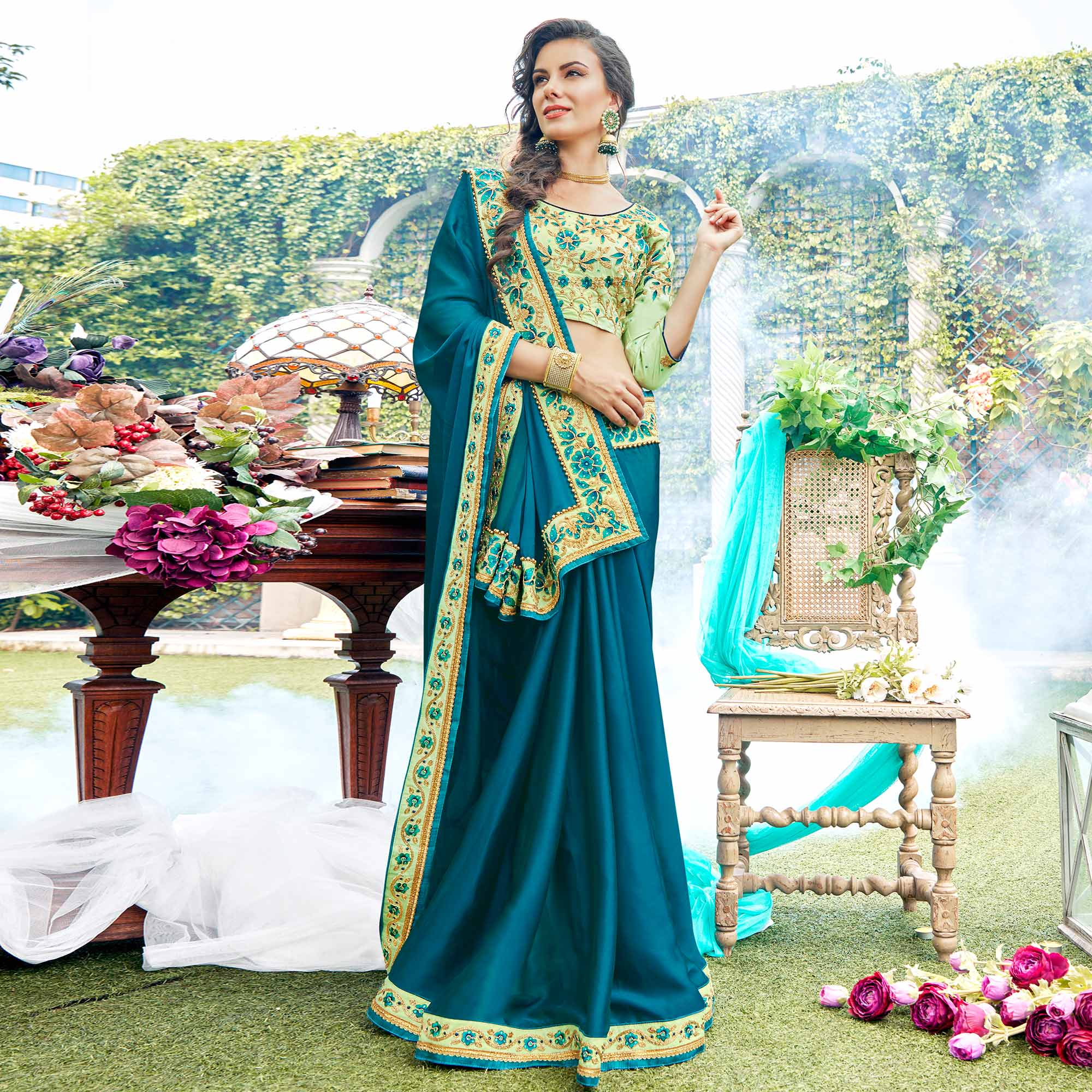 Alluring Teal Blue Colored Partywear Embroidered Georgette-Silk Saree