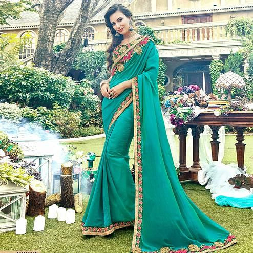Flaunt Turquoise Green Colored Partywear Embroidered Georgette-Silk Saree