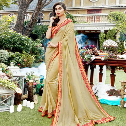 Stunning Beige Colored Partywear Embroidered Georgette-Silk Saree