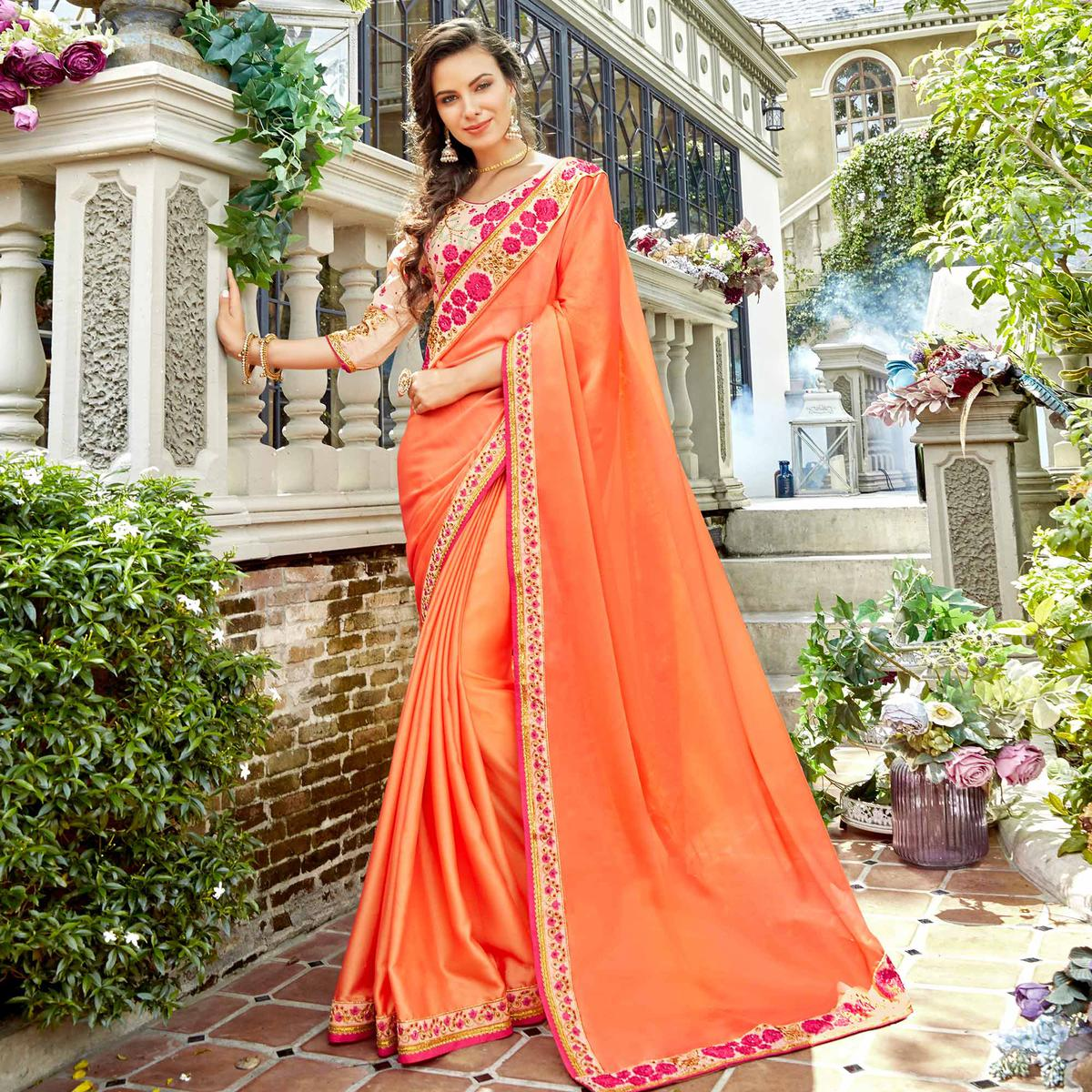 Flirty Peach Colored Partywear Embroidered Georgette-Silk Saree