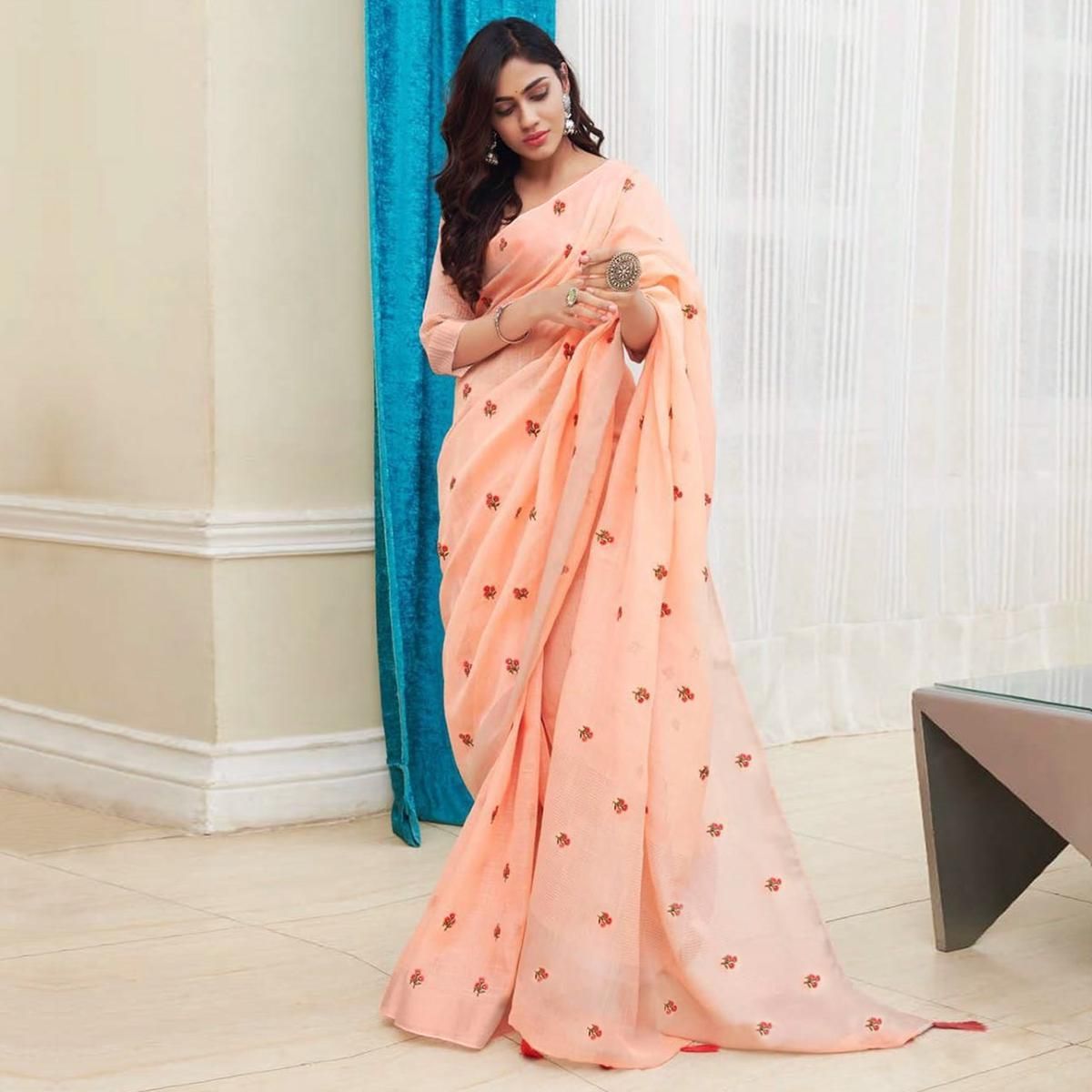 Pleasant Peach Colored Partywear Embroidered Linen Saree
