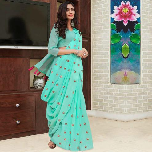 Glowing Aqua Green Colored Partywear Embroidered Linen Saree