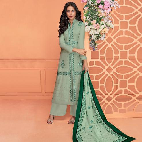 Sophisticated Turquoise Green Colored Partywear Printed Viscose Muslin Palazzo Suit