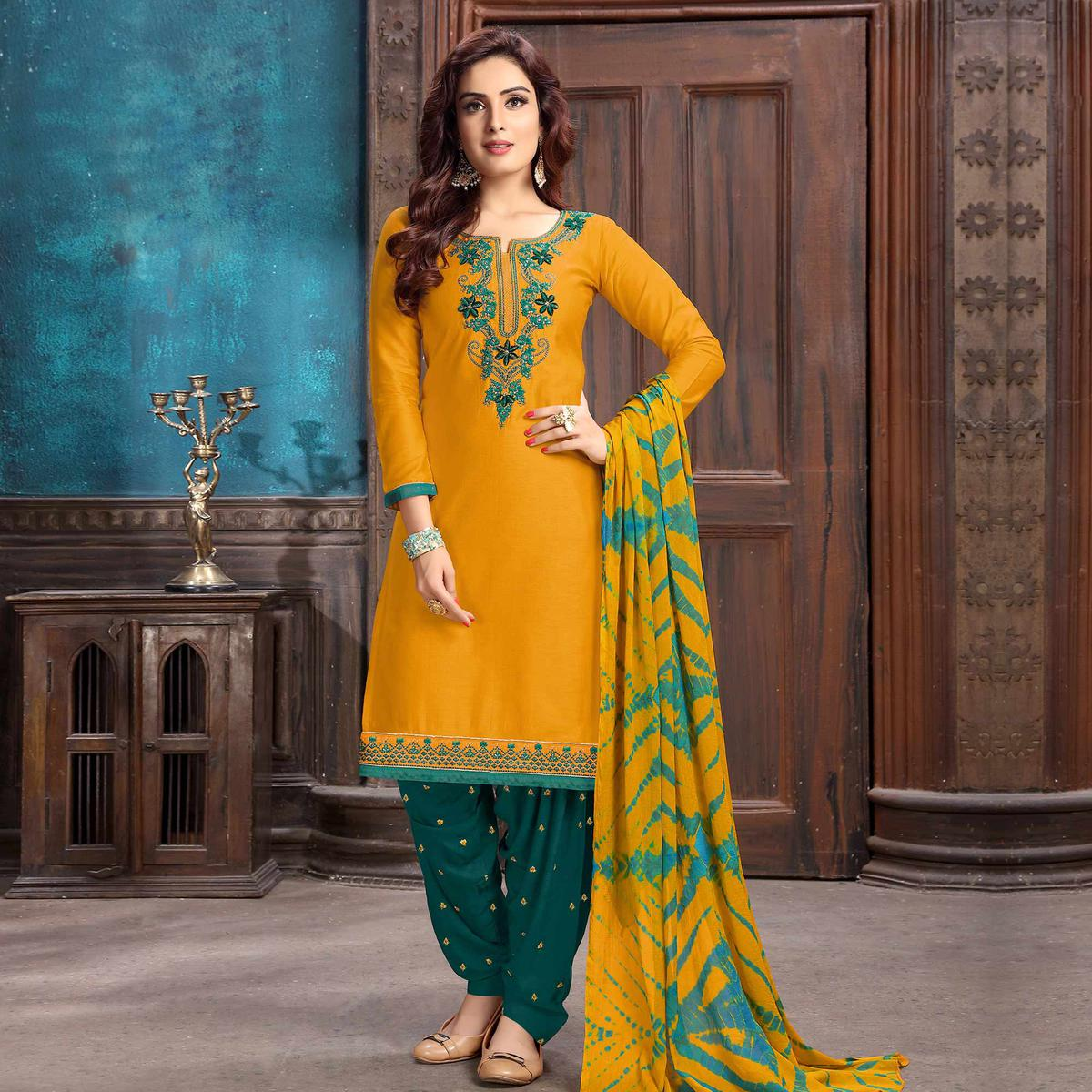 Charming Mustard Yellow Colored Partywear Embroidered Cotton Patiala Suit