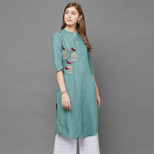 Eye-catching Turquoise Green Colored Partywear Embroidered Cotton Kurti