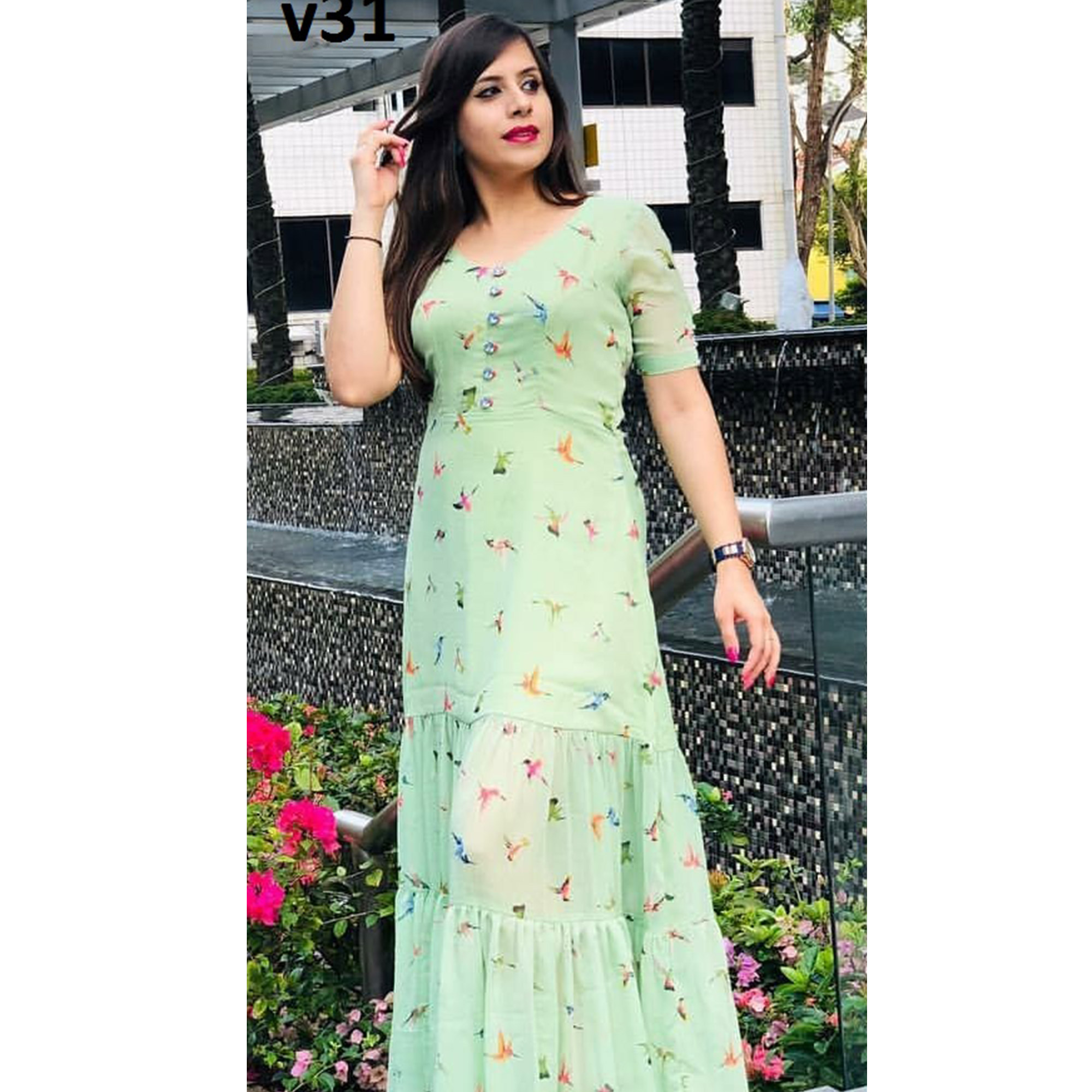 Stunning Mint Green Colored Partywear Digital Printed Georgette Long Kurti