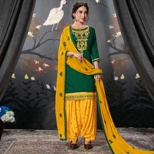 Innovative Dark Green Colored Partywear Embroidered Cotton Patiala Suit