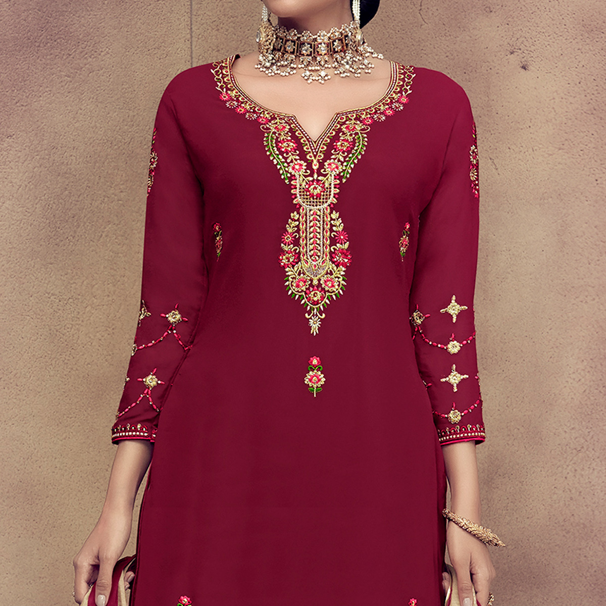 Arresting Maroon Colored Partywear Embroidered Faux Georgette Palazzo Suit