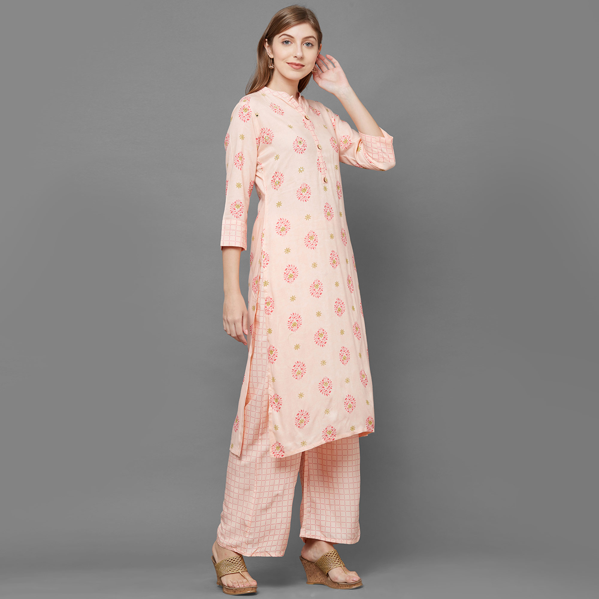 Sophisticated Peach Colored Partywear Printed Cotton Kurti-Palazzo Set
