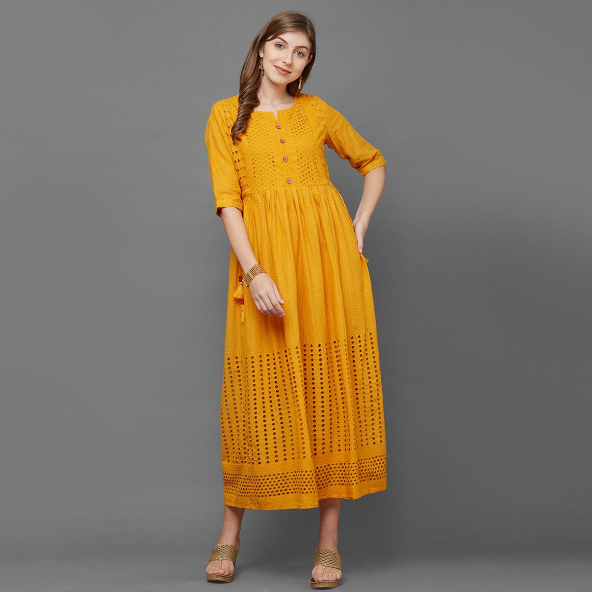 Demanding Yellow Colored Partywear Cut Work Embroidered Cotton Long Kurti