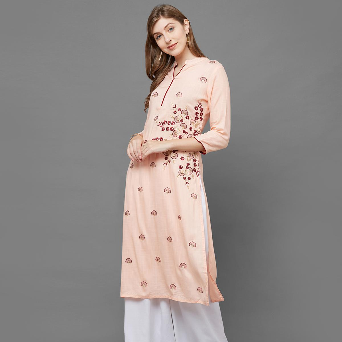 Charming Peach Colored Partywear Embroidered Cotton Kurti