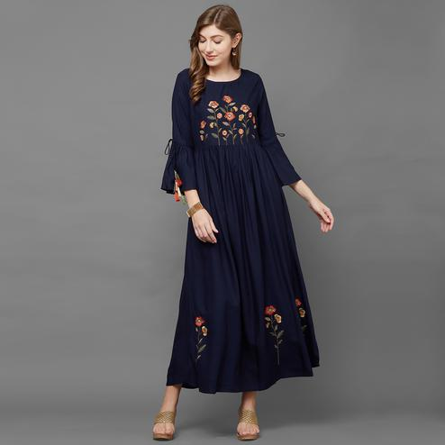 Dazzling Navy Blue Colored Partywear Floral Embroidered Cotton Kurti