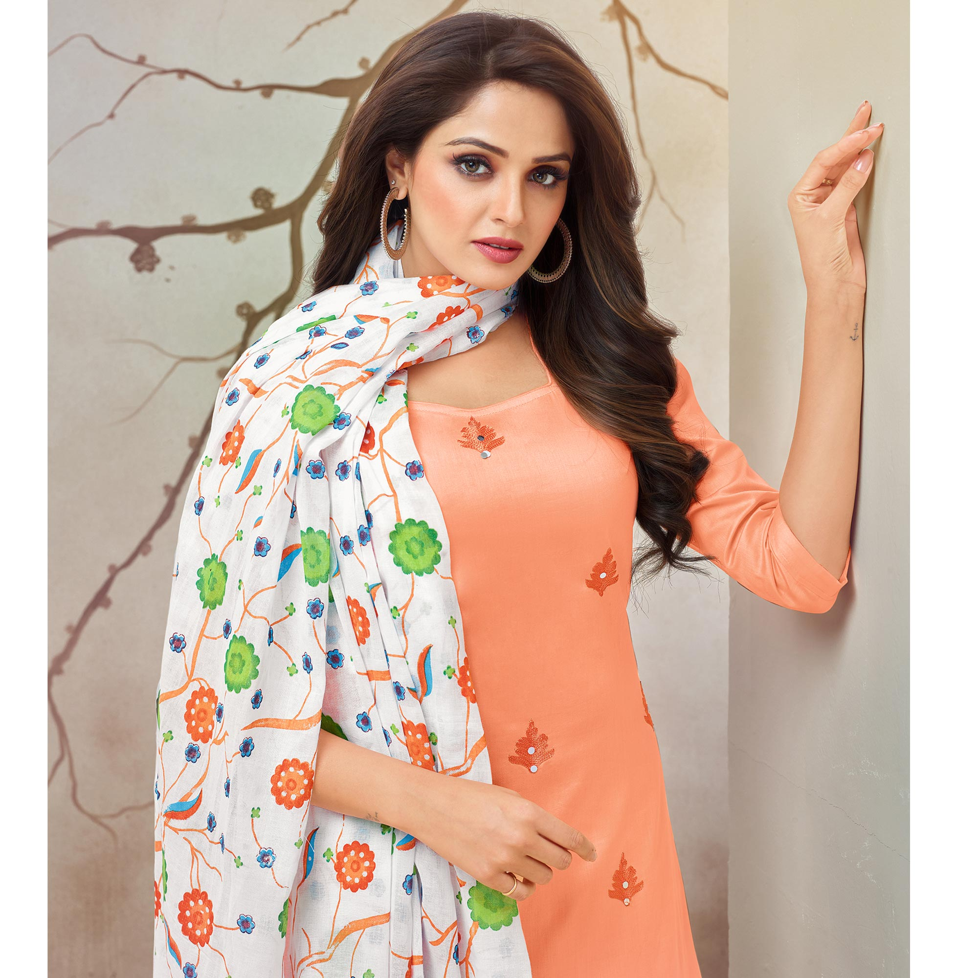 Captivating Peach Colored Partywear Embroidered Pure Cotton Palazzo Suit