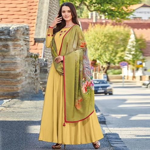 Flattering Yellow Colored Partywear Embroidered Art Silk Gown With Muslin Silk Dupatta