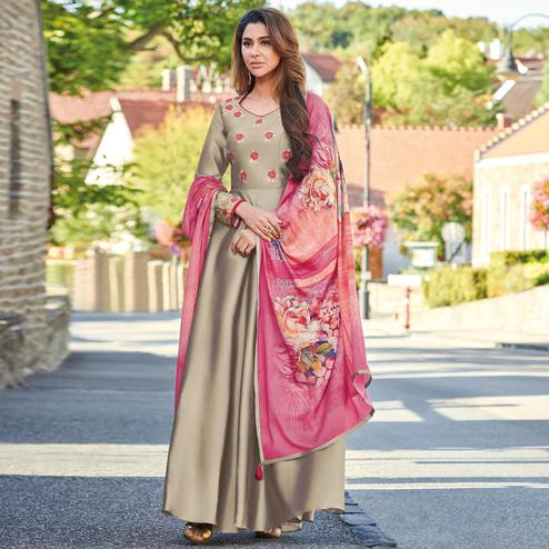 Marvellous Chiku Colored Partywear Embroidered Art Silk Gown With Muslin Silk Dupatta