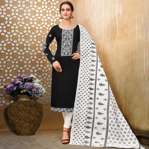 Exotic Black Colored Partywear Embroidered Pure Cotton Suit