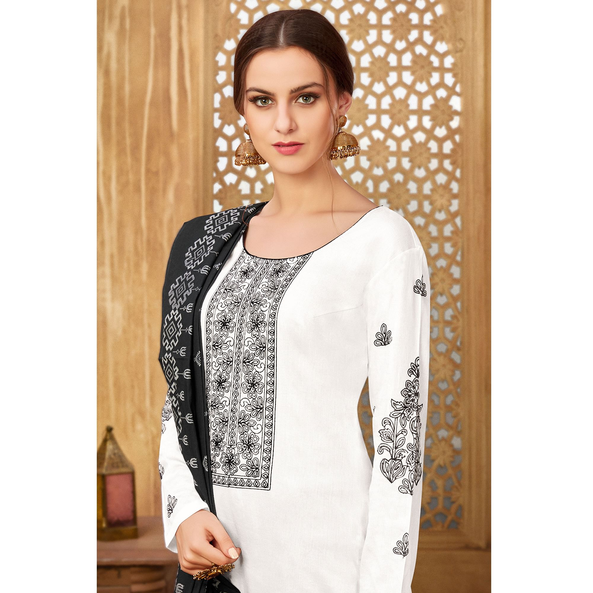 Sophisticated White Colored Partywear Embroidered Pure Cotton Suit