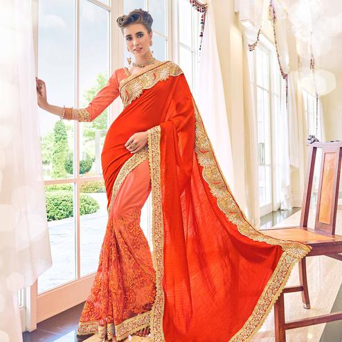 Captivating Orange Colored Partywear Embroidered Art Silk-Net Saree