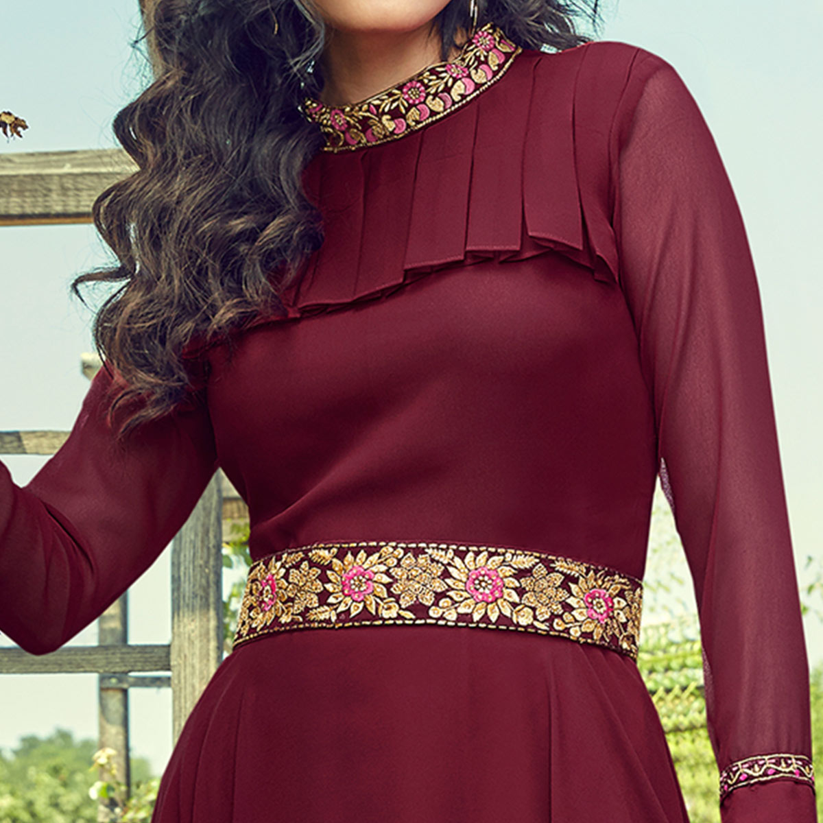 Adorning Maroon Colored Partywear Embroidered Georgette Gown