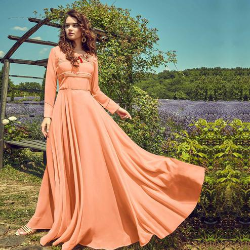 Entrancing Peach Colored Partywear Embroidered Georgette Gown