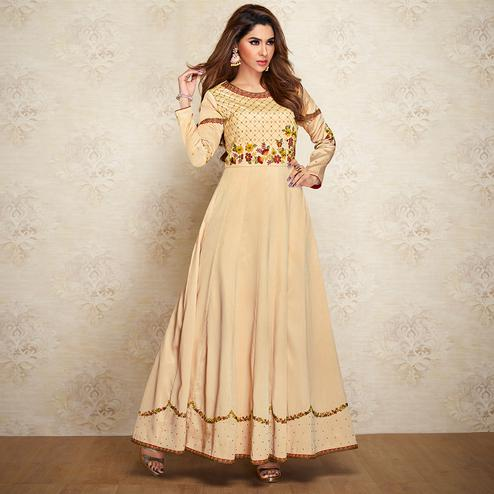 Captivating Beige Colored Partywear Embroidered Cotton Silk Gown