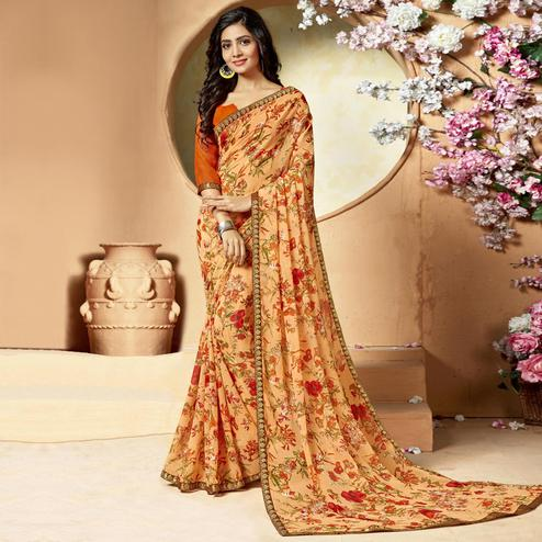 Graceful Light Orange Colored Casual Printed Chiffon Saree