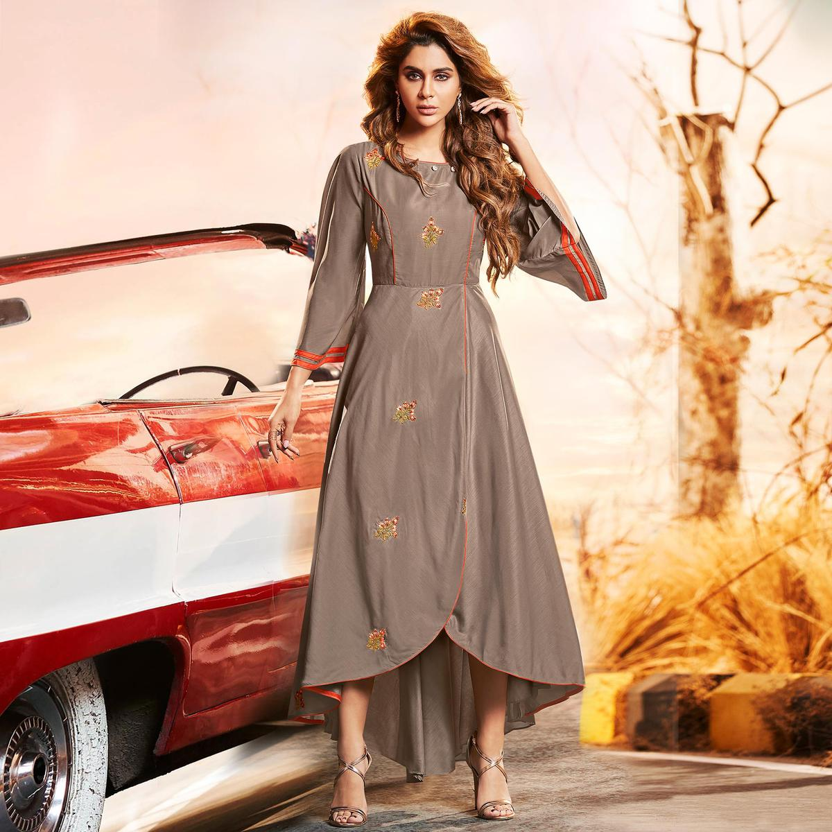 Stunning Brown Colored Partywear Embroidered Muslin Silk Gown